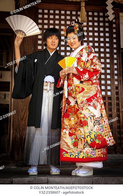 Couple ready themselves to take marriage wows at traditional Shinto wedding, Kanazawa, Japan