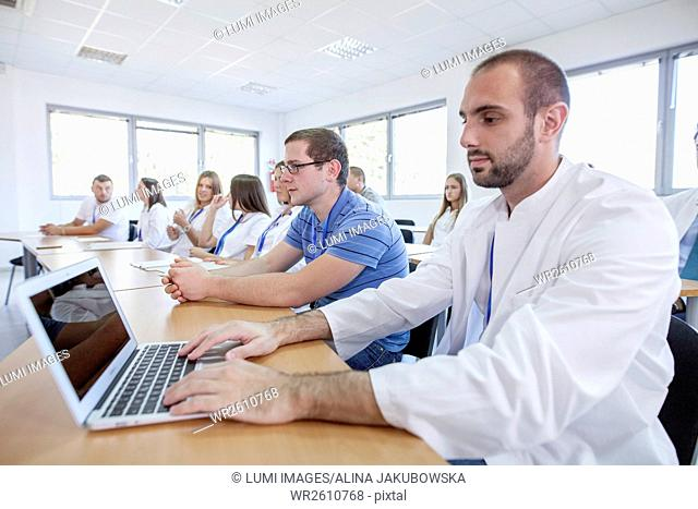 Man using laptop in training class