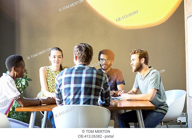 Casual business people meeting at table in office
