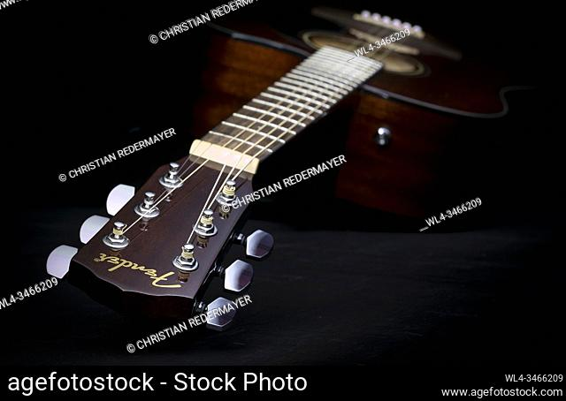 Music concept image, classic guitar on a black background, Jazz, rock, blues music or life style concept