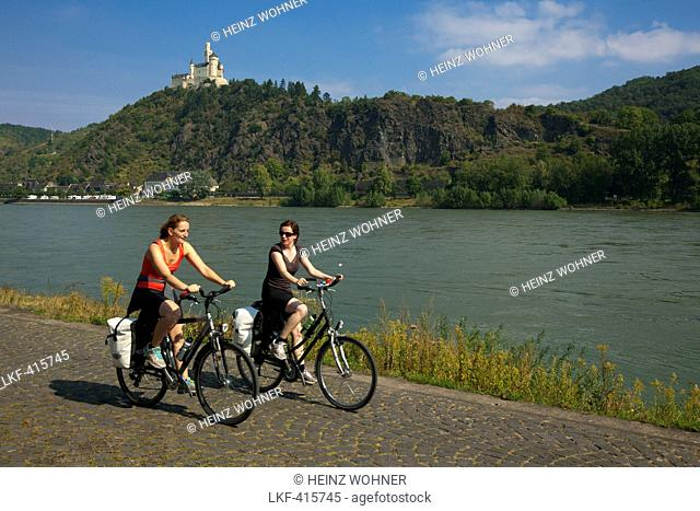 Cyclists at Marksburg castle, Unesco World Cultural Heritage, near Braubach, Rhine river, Rhineland-Palatinate, Germany