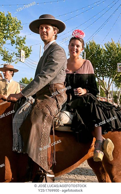 April Fair, Couple in traditional costumes on a horse, Seville, Spain