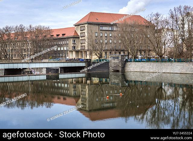 View from Kepa Mieszczanska Isle on the Oder river with State Archives and University building in Wroclaw, Silesia region of Poland
