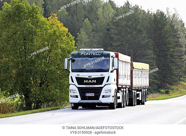 Salo, Finland - September 21, 2018: New, white MAN TGX 35. 580 cargo truck of Fontell Granite Ltd on rural highway in autumn