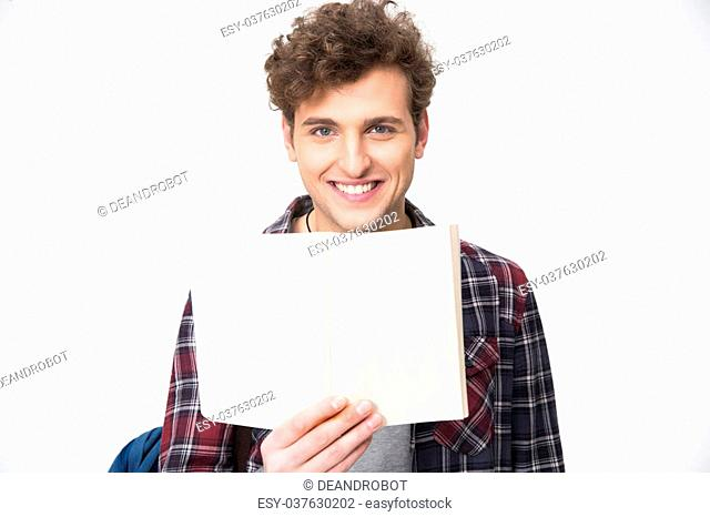 Happy young male student holding blank notebook