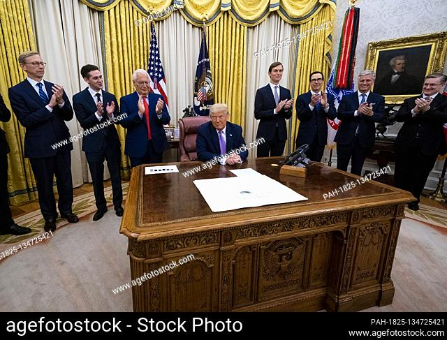 United States President Donald J. Trump, surrounded by leaders of the State of Israel and the United Arab Emirates (UAE)