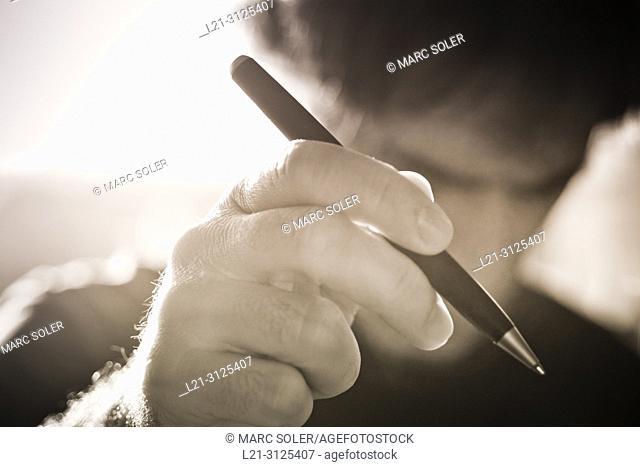 Man holding ballpoint pen