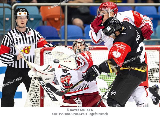 From left hockey players BRANDON MAXWELL, FILIP PAVLIK both of Hradec and KEVIN DUSSEAU of Rouen in action during the Ice hockey Champions League matches group...