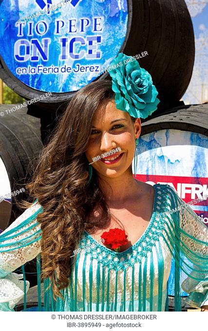 Young woman wearing a gypsy dress at the Feria del Caballo, Jerez de la Frontera, Cádiz province, Andalusia, Spain