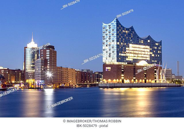 Illuminated Elbe Philharmonic Hall during blue hour, Speicherstadt, Kaiserkai, Hafencity, Hamburg, Germany, Europe