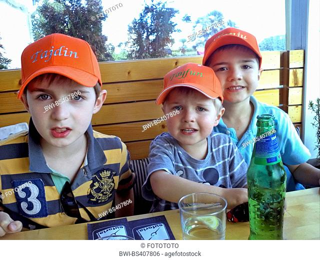 three brothers sitting together at a table