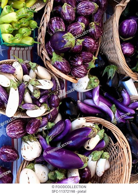 Baskets of aubergines at a farmers market