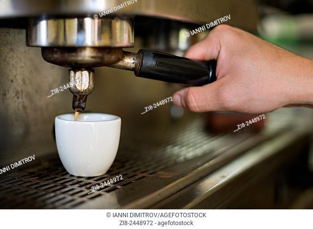 Barista pulling espresso shot-close-up