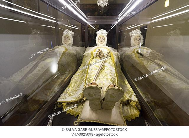 Sculpture of the Virgin of the Assumption in a glass coffin in the Casa Orduña de Guadalest Museum. this representation is taken to the processions in Holy Week...