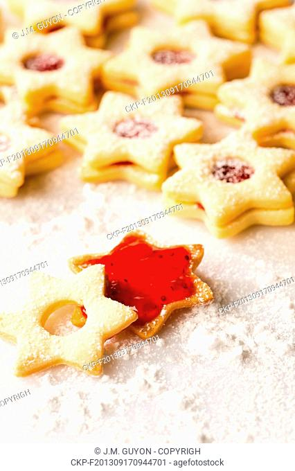 Gingerbread christmas cookie star with jam and powdered sugar