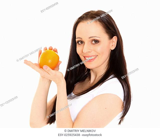 Portrait of a beautiful young woman with an orange on a white background