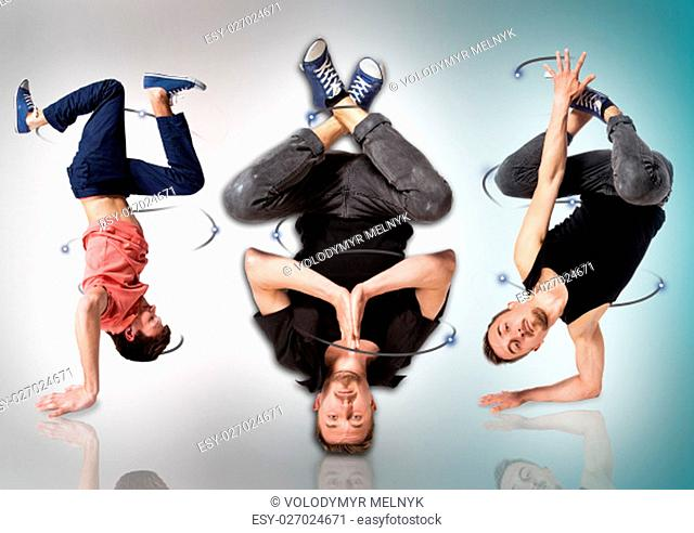 The break dancers doing handstand against white background