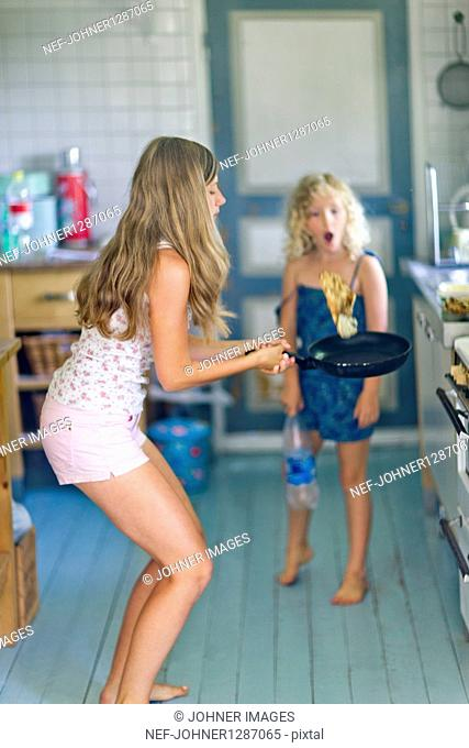 Two girls cooking in kitchen