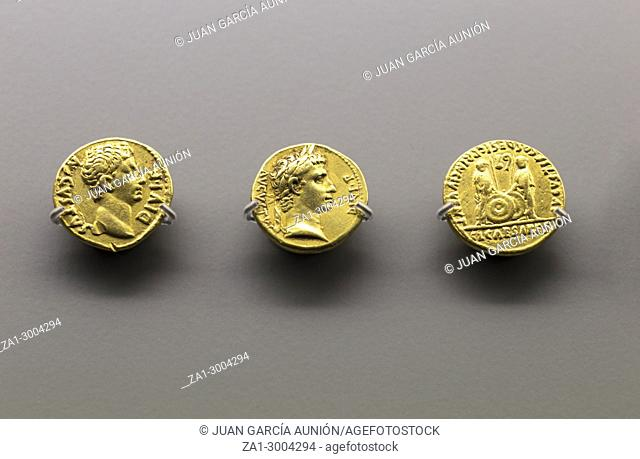 Three golden coins of Augustus Emperor at National Museum of Roman Art in Merida, Spain