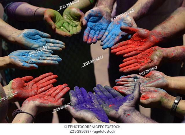 Color powder on hands during holi festival near Pune, Maharashtra