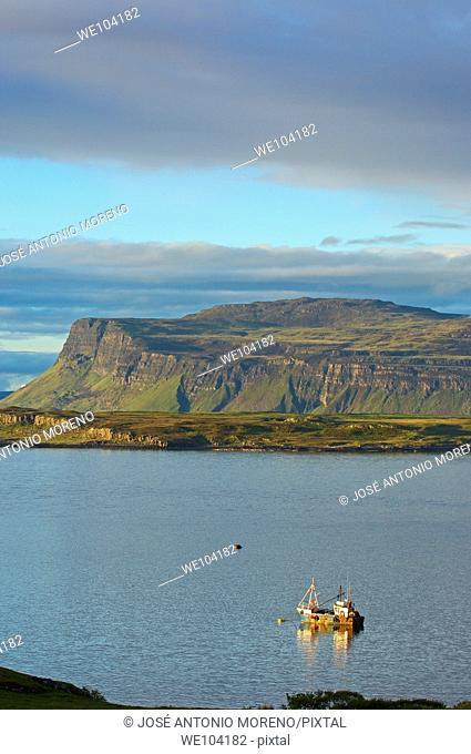 Boat at sunset in Loch Scridian, Mull, Inner Hebrides, Argyll and Bute, Scotland, United Kingdom, Europe