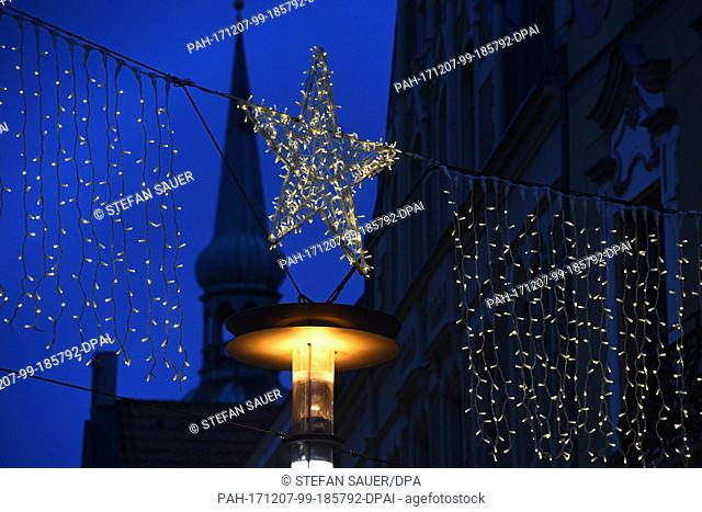 View of the shopping street Ossenreyerstrasse decorated with Christmas lights during the Advent season in Stralsund, Germany, 6 December 2017