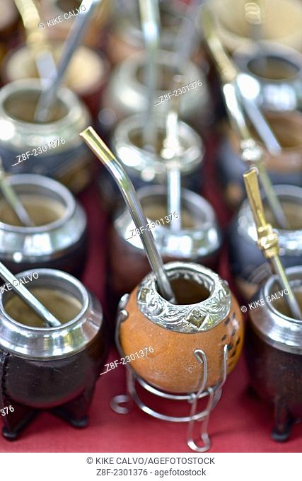 Traditional National infusion, or mate in q calabash gourd with bombilla. Constitution Square Outdoor market in Constitution Square