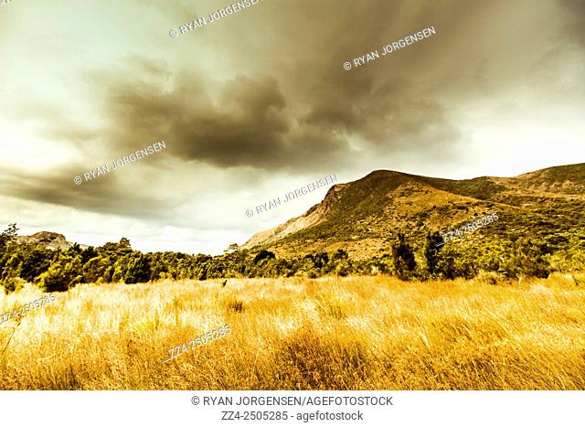 Dry tasmanian winter background with overcast clouds over mountainous regions. Gormanston, Tasmania, Australia