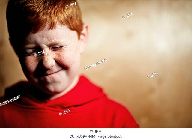 Boy with red hair, squinting