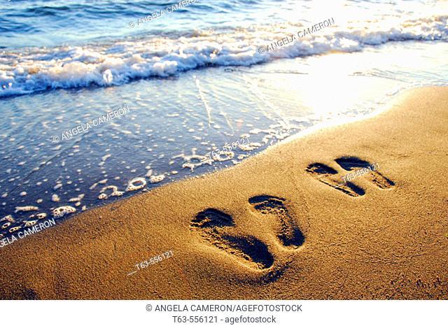 couples footprints on beach