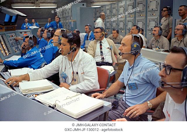 Astronaut Alan Bean (right), spacecraft communicator for the Gemini-7 mission, joins other personnel in the Blockhouse at Launch Complex 19 during the launch of...