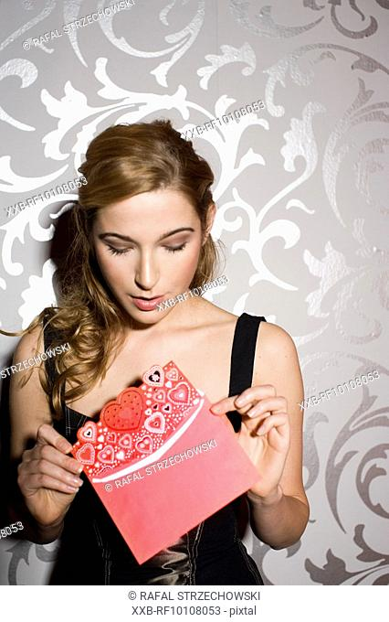 Young woman with valentine card