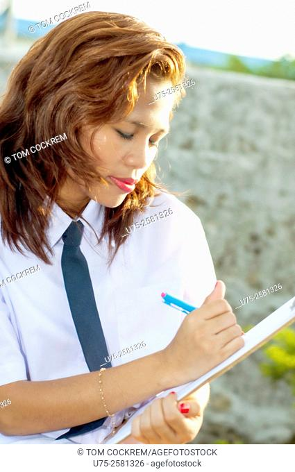 Asian female student on location, Philippines