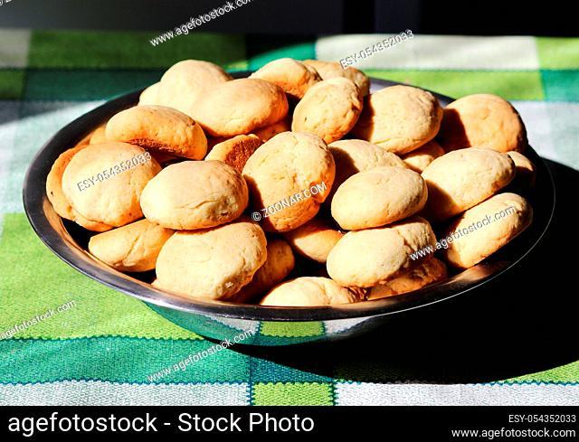 preparation of tasty homemade shortbread on sheet
