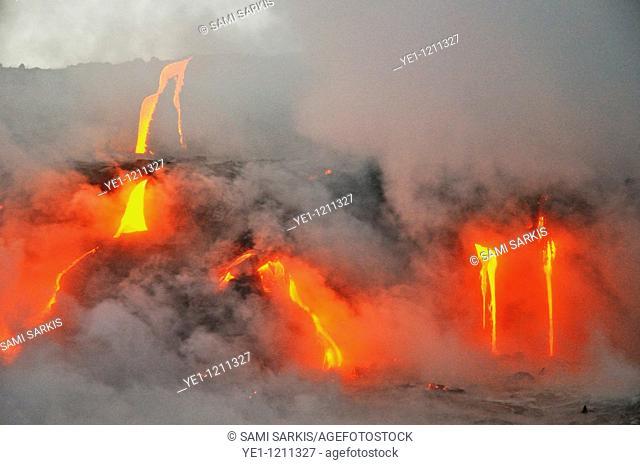 Steam rising off lava flowing into ocean, Kilauea Volcano, Hawaii Islands, USA