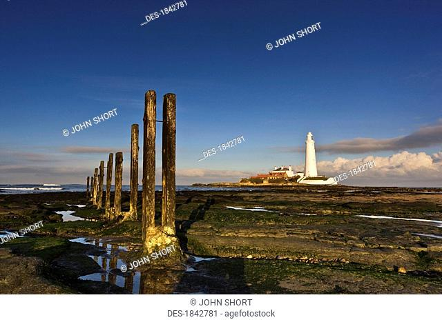Shore and lighthouse in distance, Whitley Bay, Northumberland, England
