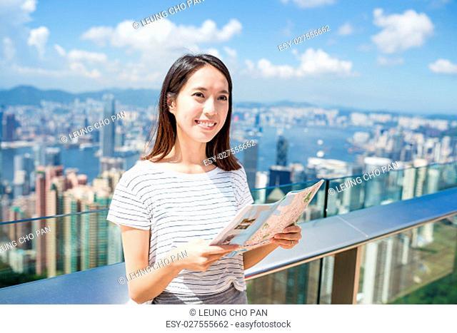 Woman using paper map in Hong Kong
