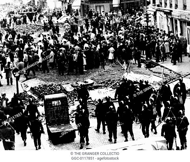 PARIS: STUDENT REVOLT, 1968Police, in the foreground, advancing on students at a barricade on Rue Gay Lussac in the Latin Quarter, Paris, France, 11 May 1968