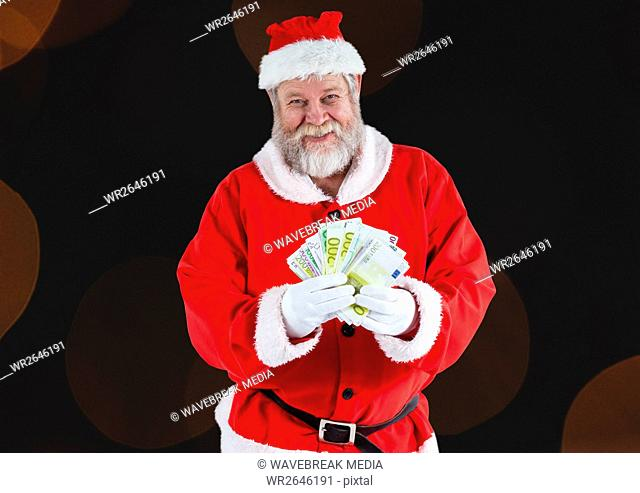 Santa claus holding euro notes