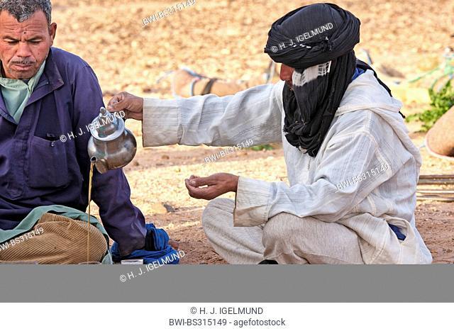 cameleers drinking tea in Sahara desert, Morocco, Souss-Massa-Dara?
