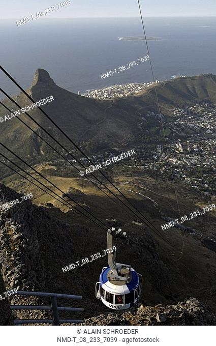 High angle view of an overhead cable car moving over mountains, Lion's Head, Table Mountain, Cape Town, Western Cape Province, South Africa