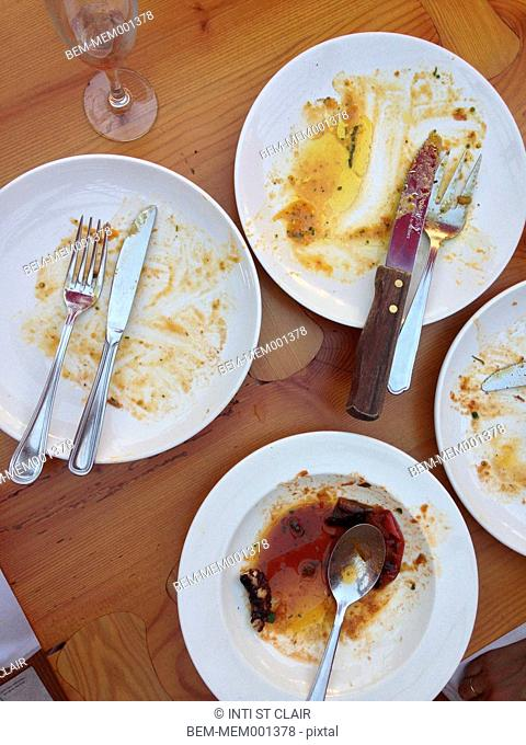 Empty plates on wooden table