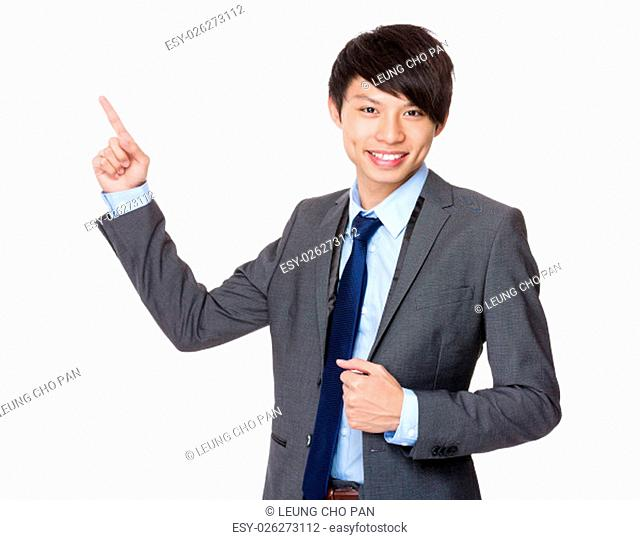 Businessman showing finger point up