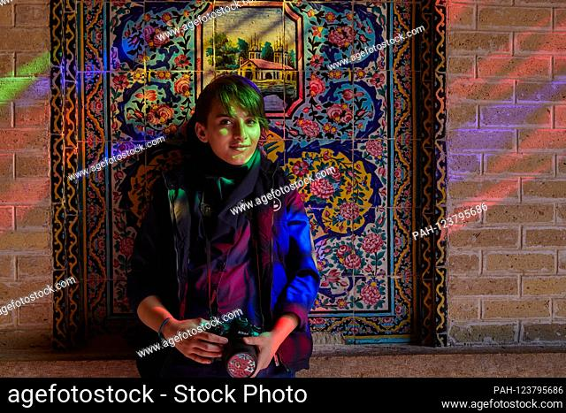 Portrait of a young woman in the Nasir-ol-Molk Mosque (Persian Masjed-e Nasir-ol-Molk), also known as the Pink Mosque in the Iranian city of Shiraz, taken on 02