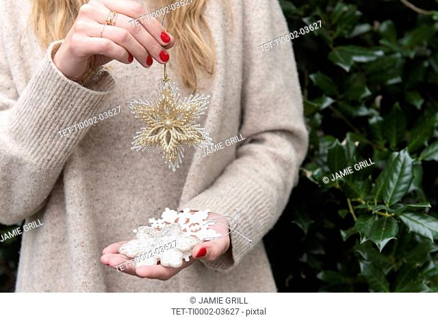Hands of woman holding Christmas decorations