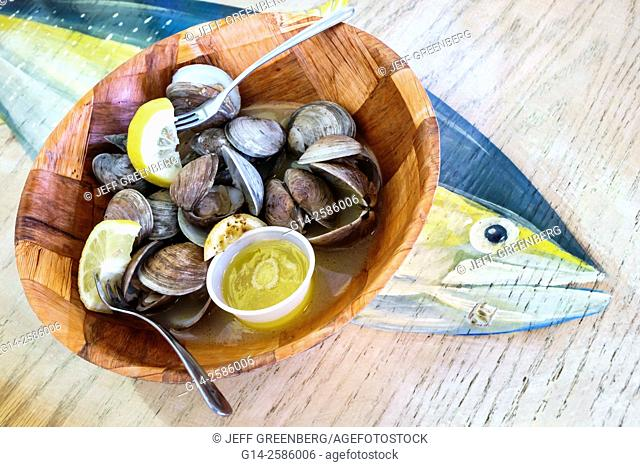 Florida, Ft. Fort Pierce, Manatee Island Bar & and Grill, restaurant, inside, seafood, bowl, steamed clams, shell, butter, sliced lemon