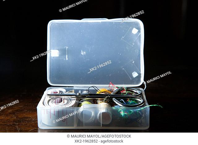 Opened plastic sewing small box