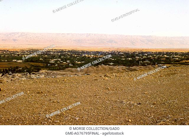 Panoramic view facing east-southeast of Jericho, West Bank, Israel, of homes and foliage in the valley below Mount Quarantania, November, 1967