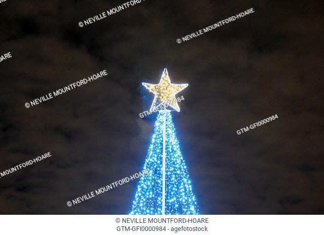 Modern Christmas tree in Greenwich beneath moody sky