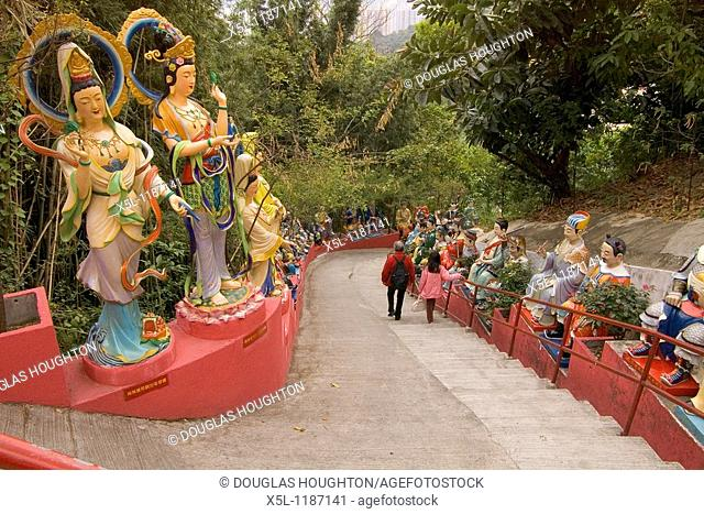 Ten Thousand Buddhas Monastery SHATIN HONG KONG Lady and girl on steps to upper temple colourful painted statues